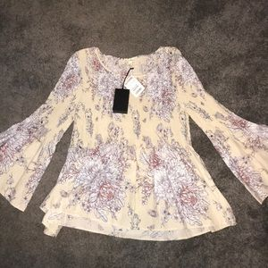 Brand new floral and peplum shirt